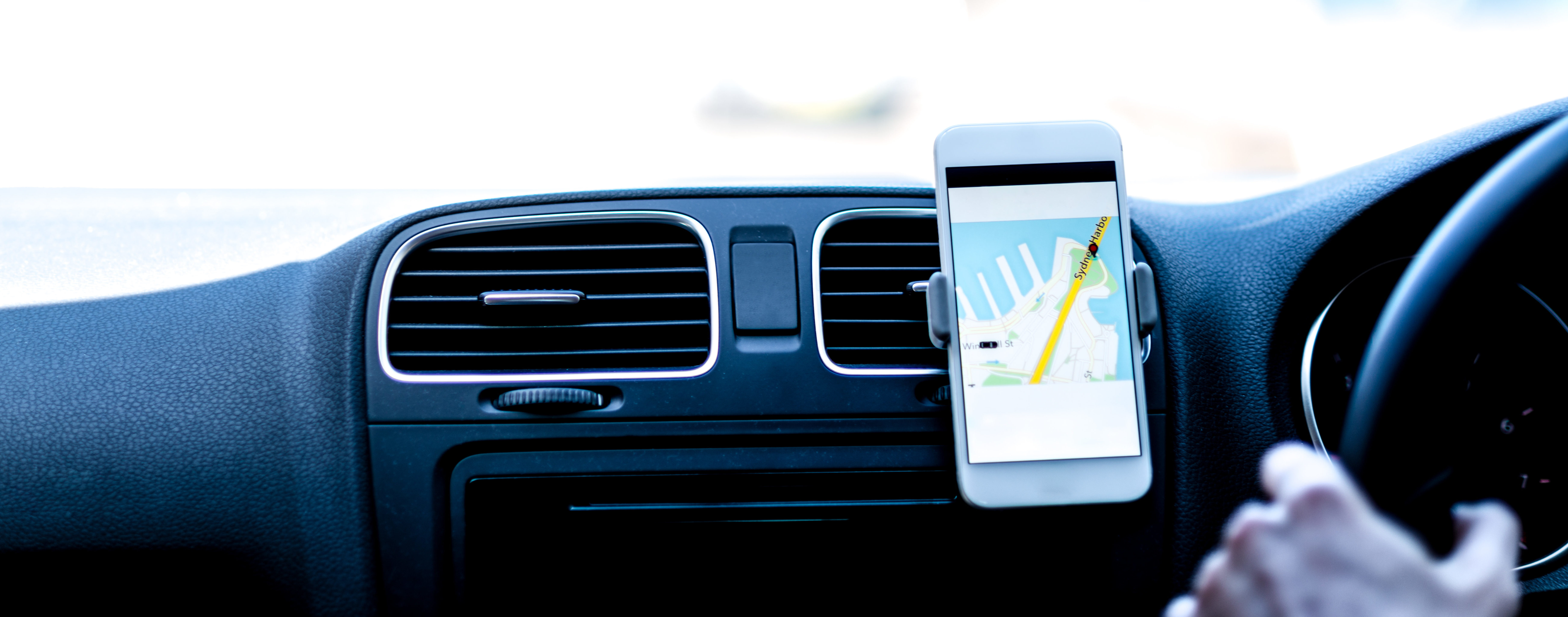 rideshare driver drives with cell phone gps